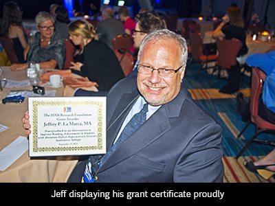 Jeffry displays his grant certificate